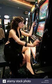 young girl gambling slot machine Stock Photo - Alamy